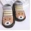ถุงเท้ารองเท้า มีกันลื่น เนื้อผ้านุ่มนิ่ม สำหรับเด็กวัย 0-2 ปี ลายหมีริ้วเทาเหลืองพื้นดำ thumbnail 1